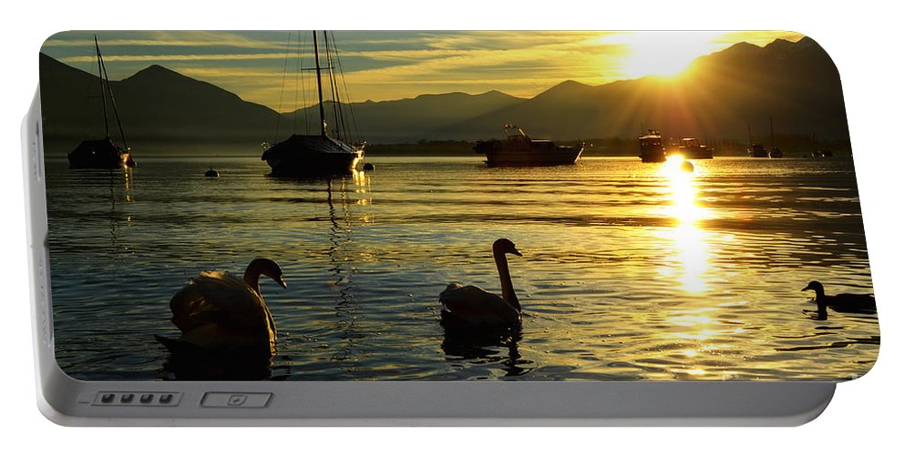 Swan Portable Battery Charger featuring the photograph Swans In Sunset by Mats Silvan