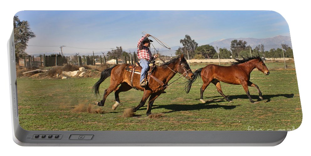 Horses Portable Battery Charger featuring the photograph The Chase by Tommy Anderson