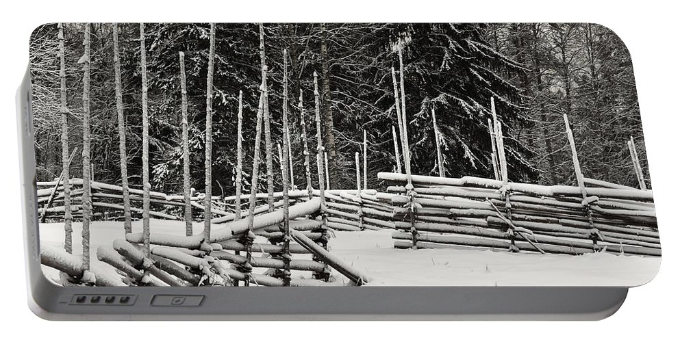 Finland Portable Battery Charger featuring the photograph The Fence Of Kovero by Jouko Lehto