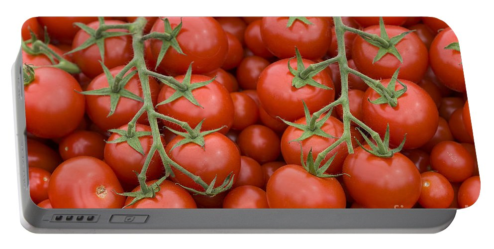 Tomato Portable Battery Charger featuring the photograph Tomato On The Vine by Lee Avison