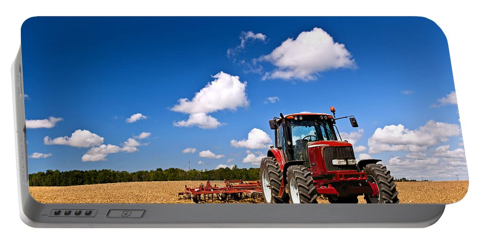 Tractor Portable Battery Charger featuring the photograph Tractor In Plowed Field 1 by Elena Elisseeva