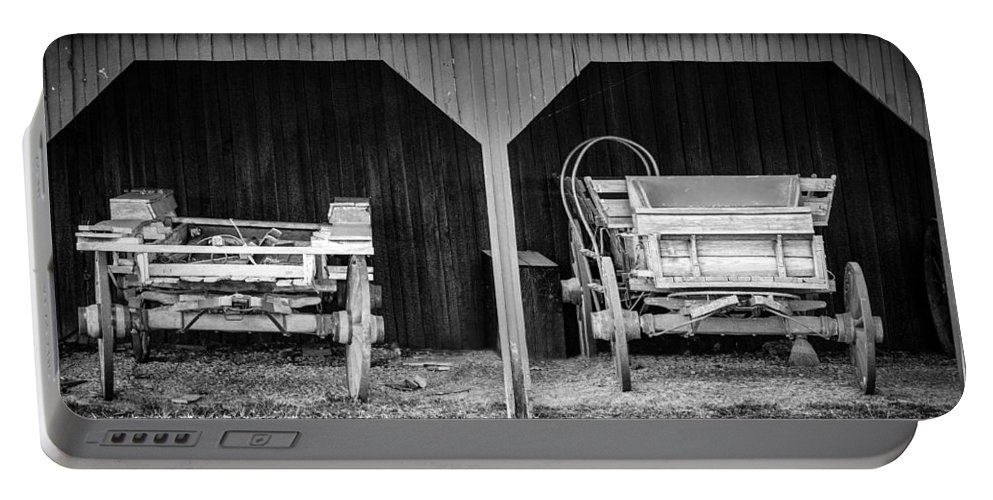 Cart Portable Battery Charger featuring the photograph Two Carts by Alexey Stiop