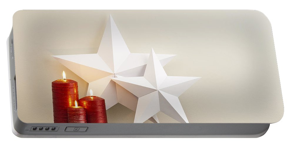 Advent Portable Battery Charger featuring the photograph Two Stars With Red Candles by U Schade