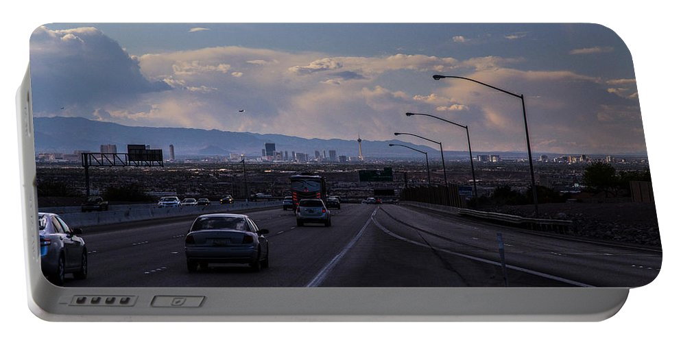 Las Vegas Portable Battery Charger featuring the photograph Vegas Cityscape by Angus Hooper Iii