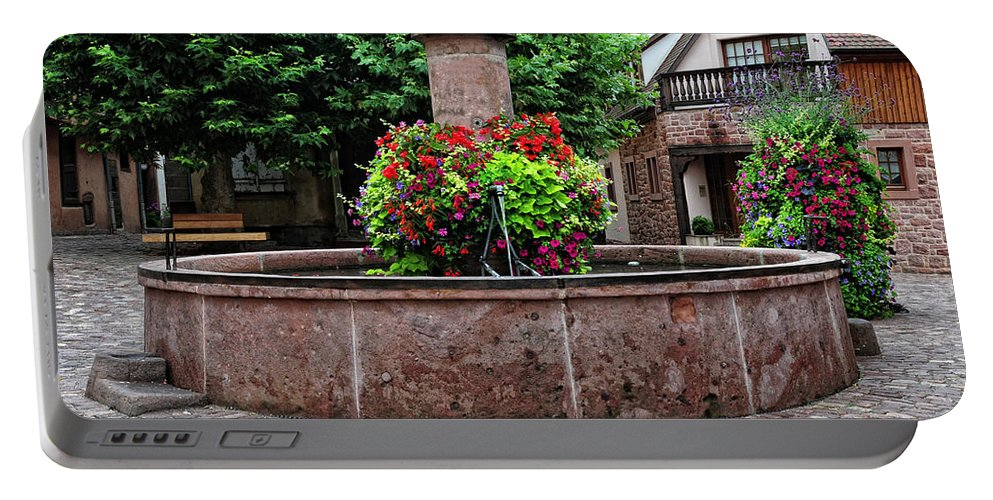 Fountain Portable Battery Charger featuring the photograph Village Fountain In Provence by Dave Mills