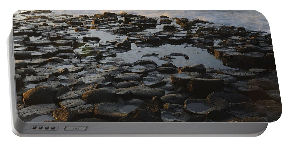 Landscape Portable Battery Charger featuring the photograph The Giants Causeway by John Shaw