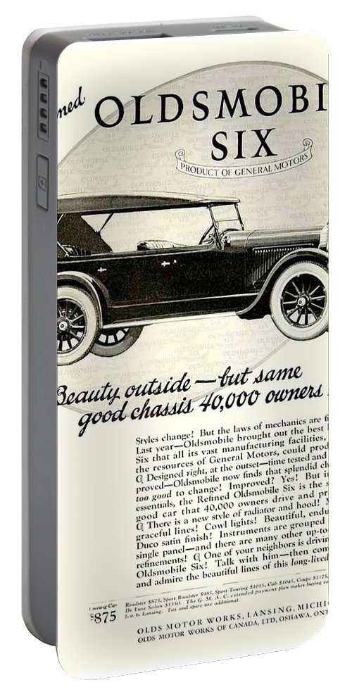1924 Portable Battery Charger featuring the digital art 1924 - Oldsmobile Six Automobile Advertisement by John Madison