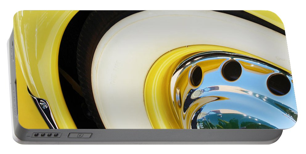1937 Cord 812 Phaeton Wheel Rim Reflecting Cadillac Portable Battery Charger featuring the photograph 1937 Cord 812 Phaeton Wheel Rim Reflecting Cadillac by Jill Reger