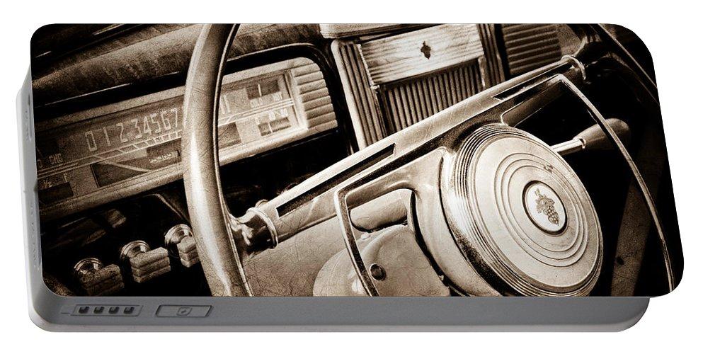 1941 Packard Steering Wheel Emblem Portable Battery Charger featuring the photograph 1941 Packard Steering Wheel Emblem by Jill Reger