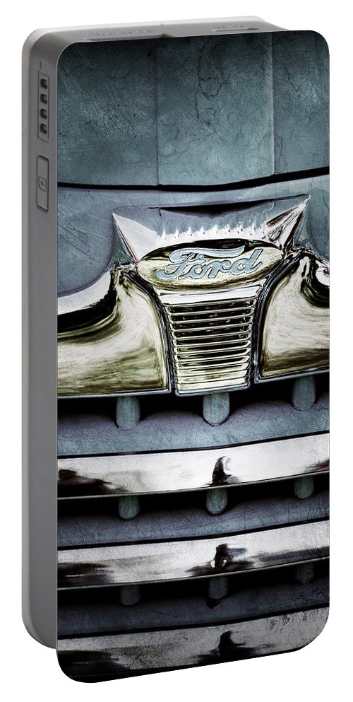 1947 Ford Deluxe Grille Emblem Portable Battery Charger featuring the photograph 1947 Ford Deluxe Grille Emblem by Jill Reger