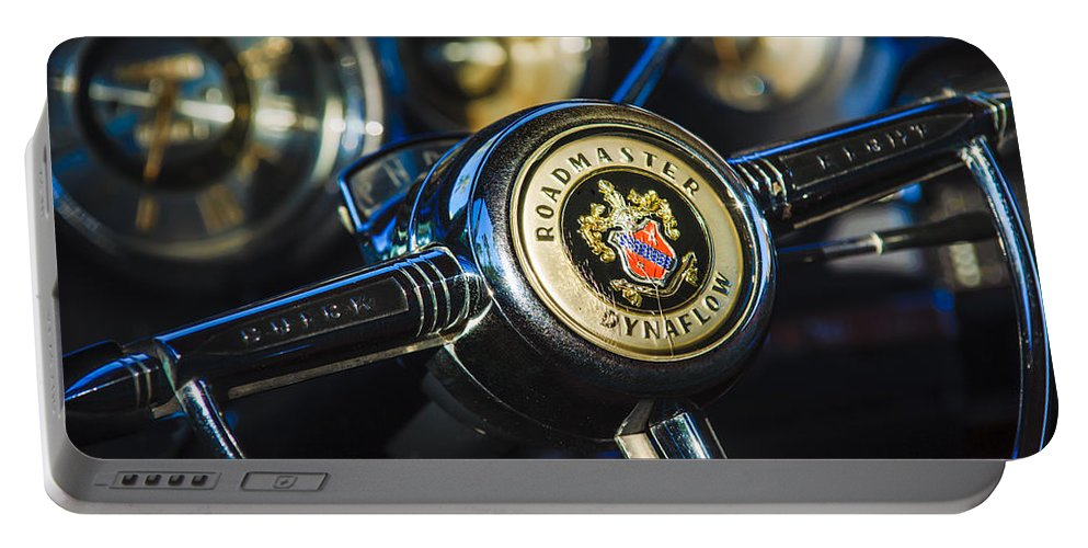 1949 Buick Roadmaster Riviera Coupe Steering Wheel Emblem Portable Battery Charger featuring the photograph 1949 Buick Roadmaster Riviera Coupe Steering Wheel Emblem by Jill Reger