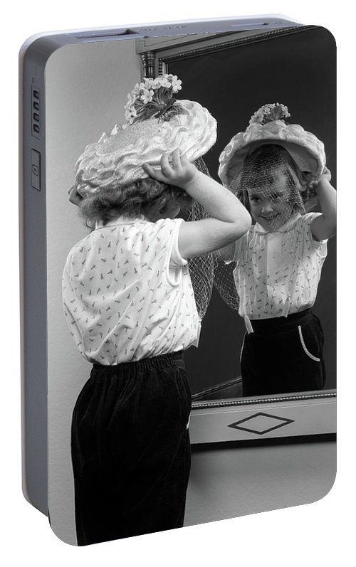 Photography Portable Battery Charger featuring the photograph 1950s Little Girl Trying On Hat Looking by Vintage Images