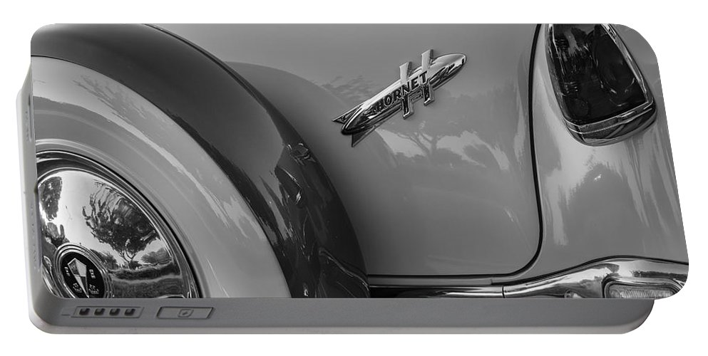 1954 Hudson Portable Battery Charger featuring the photograph 1954 Hudson Hornet by Dennis Hedberg