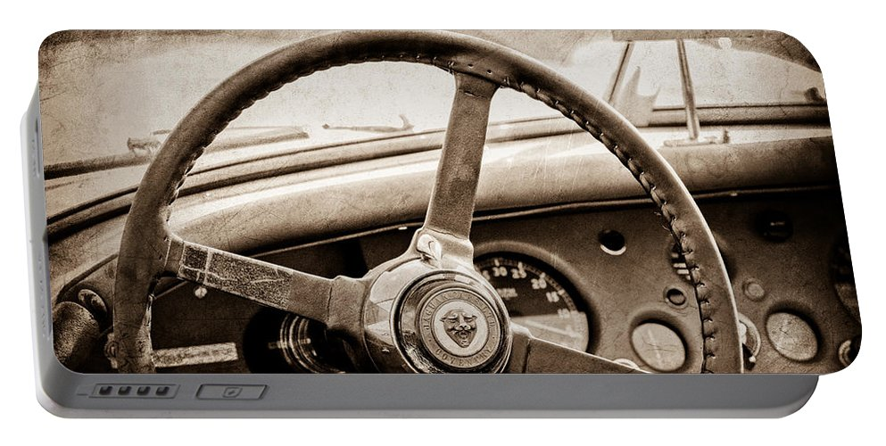 1954 Jaguar Xk120 Roadster Steering Wheel Emblem Portable Battery Charger featuring the photograph 1954 Jaguar Xk120 Roadster Steering Wheel Emblem by Jill Reger