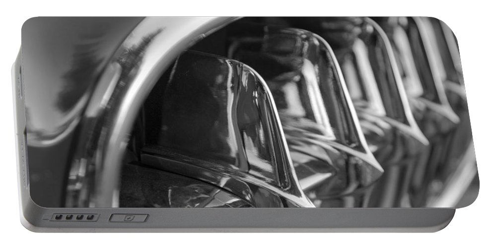 Transportation Portable Battery Charger featuring the photograph 1957 Corvette Grille Black And White by Jill Reger