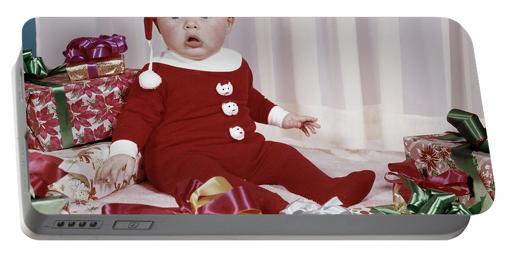 Photography Portable Battery Charger featuring the photograph 1960s Amazed Baby In Santa Suit Sitting by Vintage Images