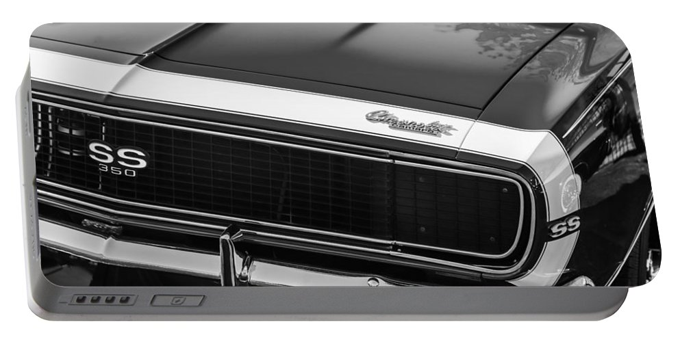 1967 Chevrolet Camaro Ss350 Convertible Grille Emblem Portable Battery Charger featuring the photograph 1967 Chevrolet Camaro Ss350 Convertible Grille Emblem -0704bw by Jill Reger