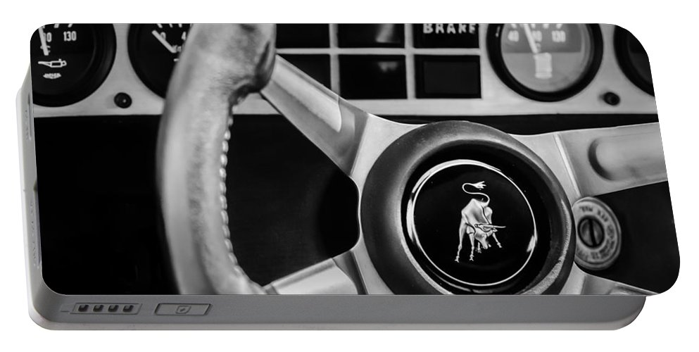 1982 Lamborghini Countach 5000s Steering Wheel Emblem Portable Battery Charger featuring the photograph 1982 Lamborghini Countach 5000s Steering Wheel Emblem -1549bw by Jill Reger