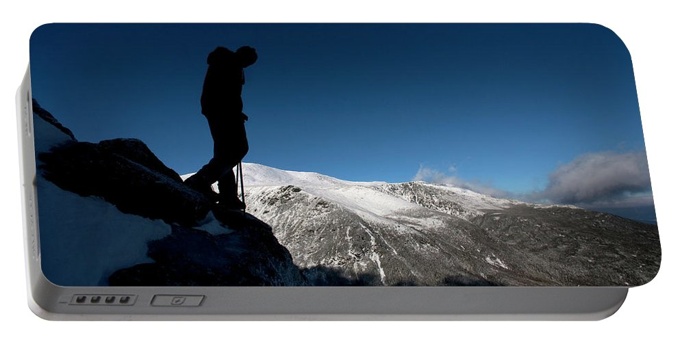 30s Portable Battery Charger featuring the photograph A Man Hikes The Boott Spur Link by Jose Azel