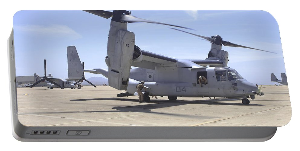 Horizontal Portable Battery Charger featuring the photograph An Mv-22 Osprey Taxiing At Marine Corps by Timm Ziegenthaler