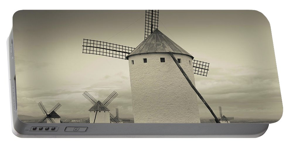 Photography Portable Battery Charger featuring the photograph Antique Windmills In A Field, Campo De 2 by Panoramic Images