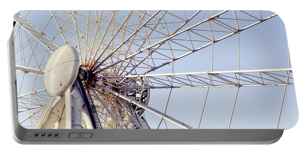 Action Portable Battery Charger featuring the photograph Big Wheel 2 by Tom Gowanlock