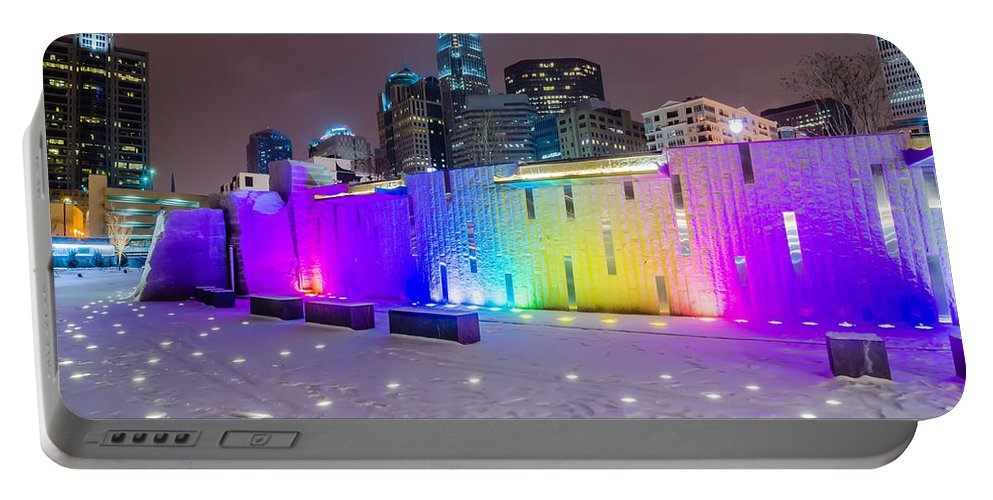 Charlotte Portable Battery Charger featuring the photograph Charlotte Queen City Skyline Near Romare Bearden Park In Winter Snow by Alex Grichenko