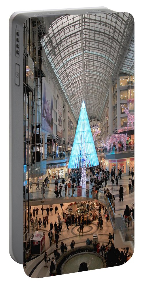 Shopping Portable Battery Charger featuring the photograph Christmas Shopping In Toronto by Valentino Visentini