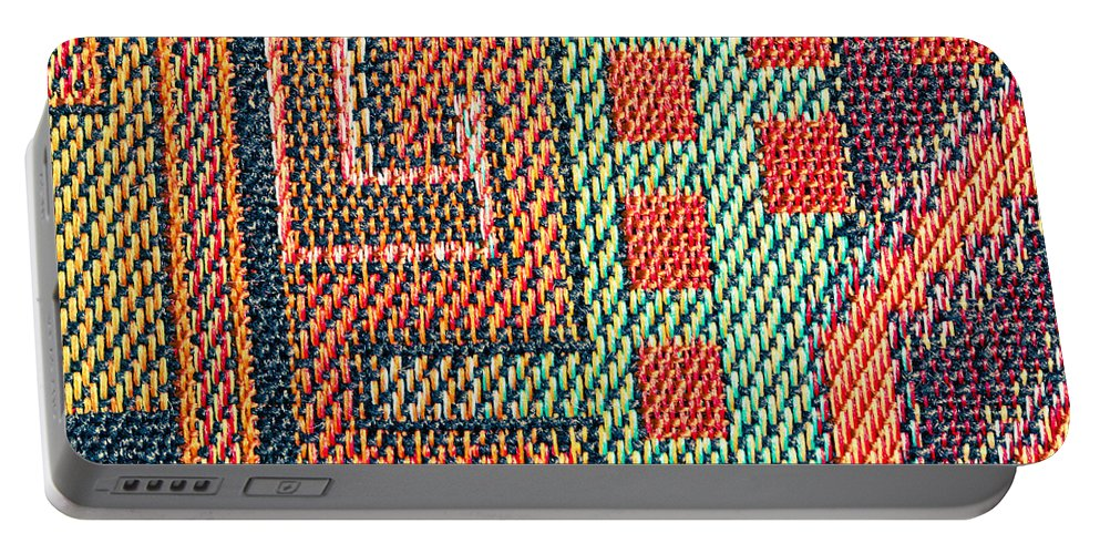 Abstract Portable Battery Charger featuring the photograph Cloth Pattern by Tom Gowanlock