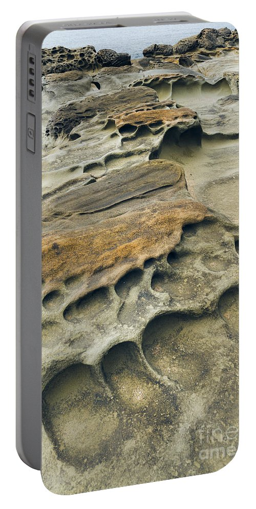 Nature Portable Battery Charger featuring the photograph Eroded Sandstone Cliff Along The Ocean by John Shaw