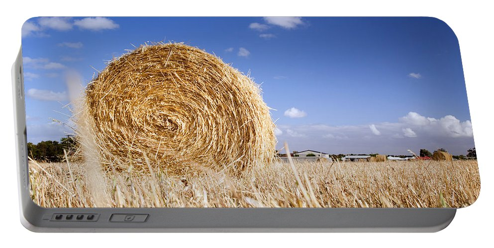 Farm Portable Battery Charger featuring the photograph Hay Bales by Tim Hester