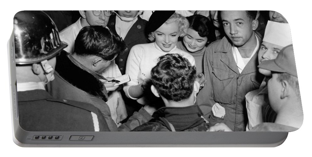 1954 Portable Battery Charger featuring the photograph Marilyn Monroe In Korea by Underwood Archives