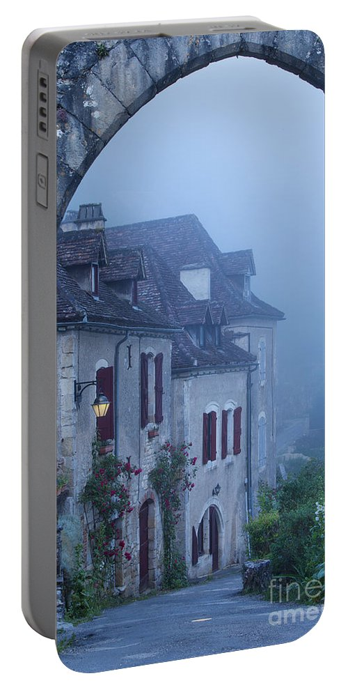 Arch Portable Battery Charger featuring the photograph Misty Dawn In Saint Cirq Lapopie by Brian Jannsen