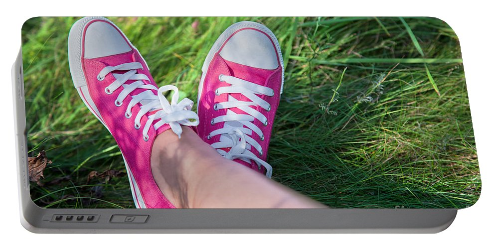 Grass Portable Battery Charger featuring the photograph Pink Sneakers On Girl Legs On Grass by Michal Bednarek