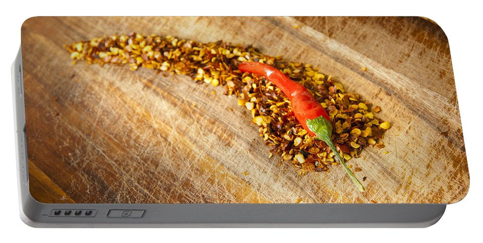Background Portable Battery Charger featuring the photograph Red Hot Chilli Concept by Tim Hester