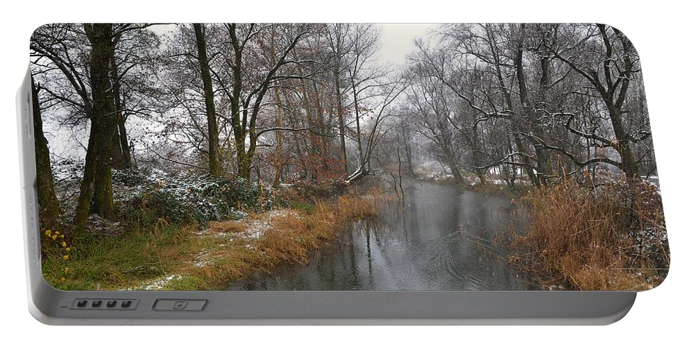 River Portable Battery Charger featuring the photograph River With Snow by Mats Silvan