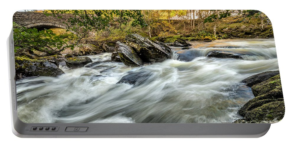 Waterscape Portable Battery Charger featuring the photograph Rocky River by Adrian Evans
