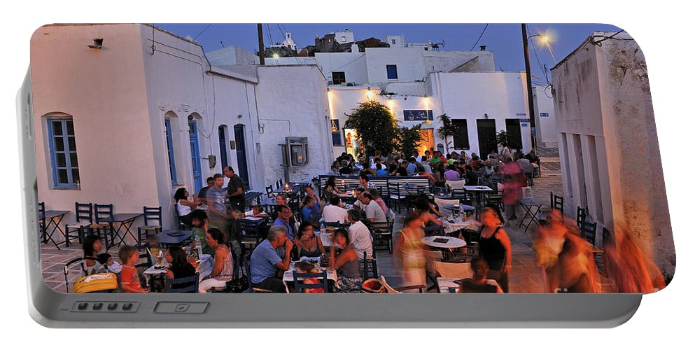 Serifos; Chora; Hora; City; Town; Greece; Greek; Hellas; Cyclades; Island; Kyklades; Aegean; Islands; People; Tourists; Agios Athanasios; Square; Dusk; Twilight; Night; Lights; Holidays; Vacation; Travel; Trip; Voyage; Journey; Tourism; Touristic; Summer; Blue Sky; Restaurant; Tavern; Cafe; Cafeteria; Bar Portable Battery Charger featuring the photograph Serifos Town During Dusk Time by George Atsametakis