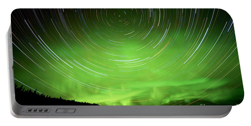 Astro Portable Battery Charger featuring the photograph Star Trails And Northern Lights In Night Sky by Stephan Pietzko