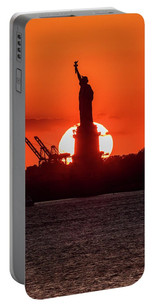 Photography Portable Battery Charger featuring the photograph Statue Of Liberty Sunset. Nyc Harbor by Panoramic Images
