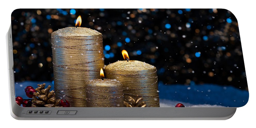 Decoration Portable Battery Charger featuring the photograph Three Gold Candles In Snow by U Schade