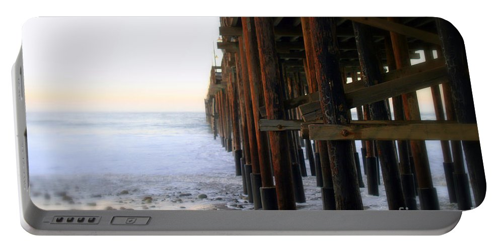 Sunrise Portable Battery Charger featuring the photograph Ocean Wave Storm Pier by Henrik Lehnerer