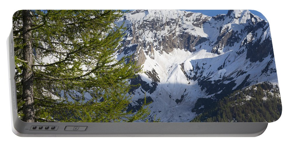 Snow-capped Portable Battery Charger featuring the photograph Snow-capped Mountain by Mats Silvan