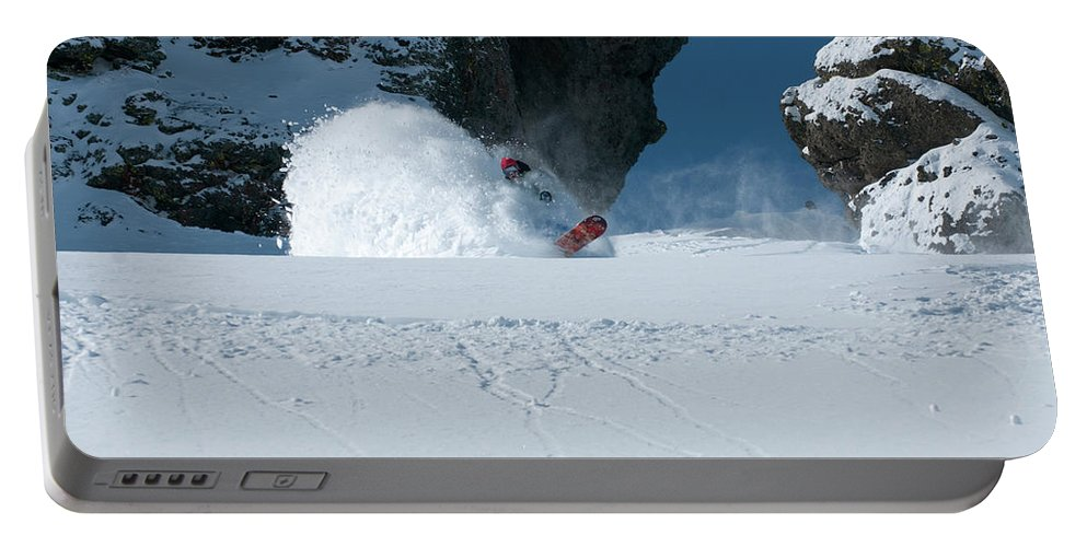 Adult Portable Battery Charger featuring the photograph A Male Snowboarder Makes A Series by Jason Abraham