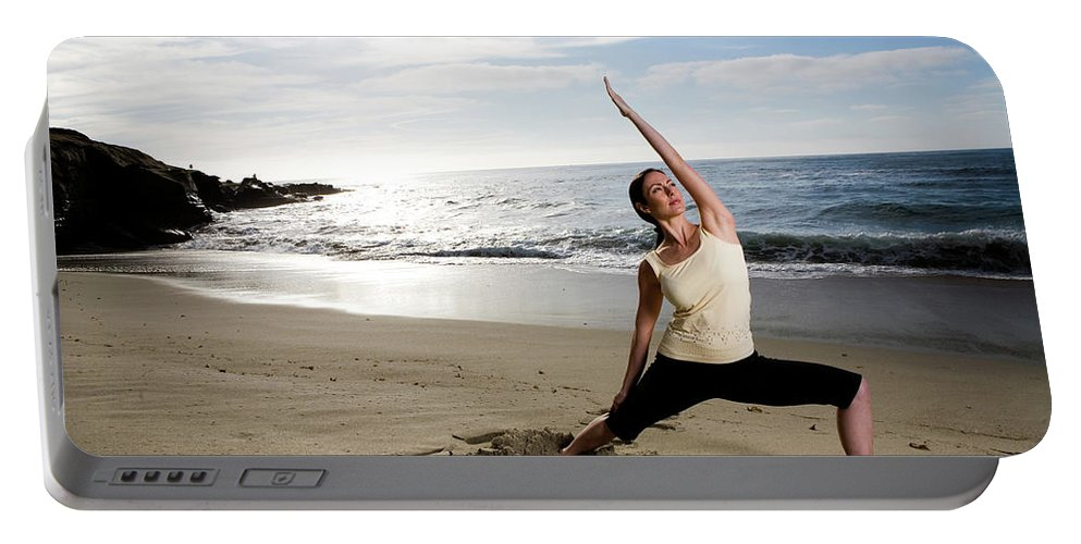 30-40 Years Old Portable Battery Charger featuring the photograph A Women At The Beach Performing Yoga by Jay Reilly