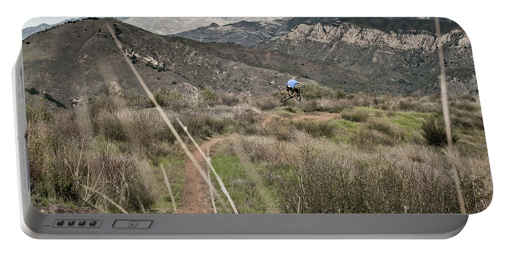 Adult Portable Battery Charger featuring the photograph A Young Man Rides His Downhill Mountain by R. Tyler Gross