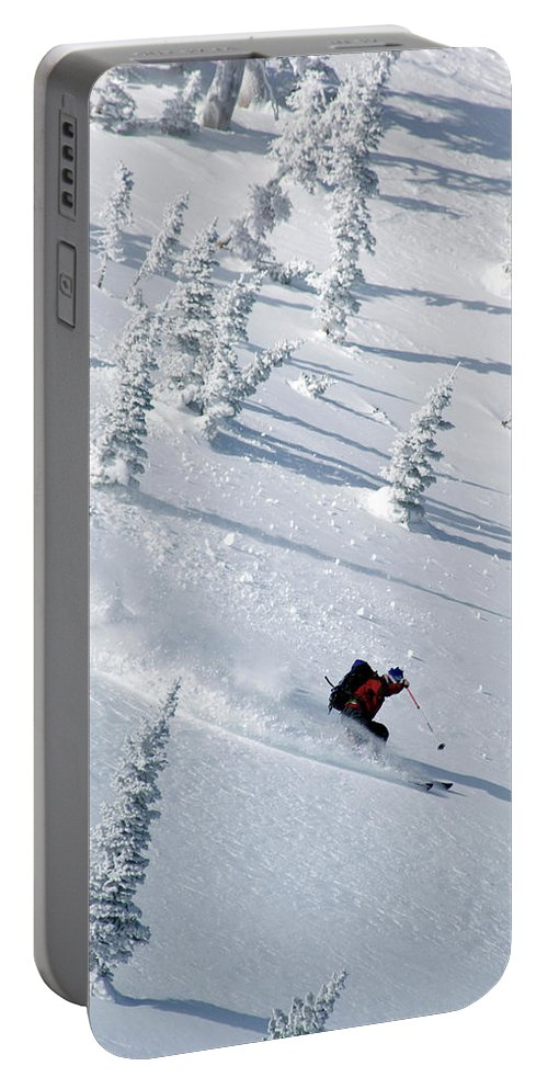 Adventure Portable Battery Charger featuring the photograph Backcountry Ski Traverse In Glacier by Heath Korvola