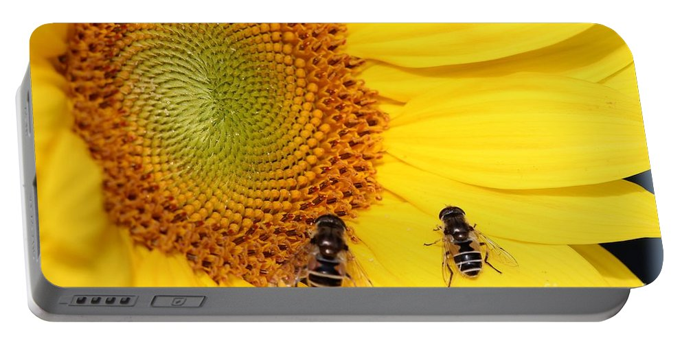 Mccombie Portable Battery Charger featuring the photograph Chipmunk's Peredovik Sunflower by J McCombie