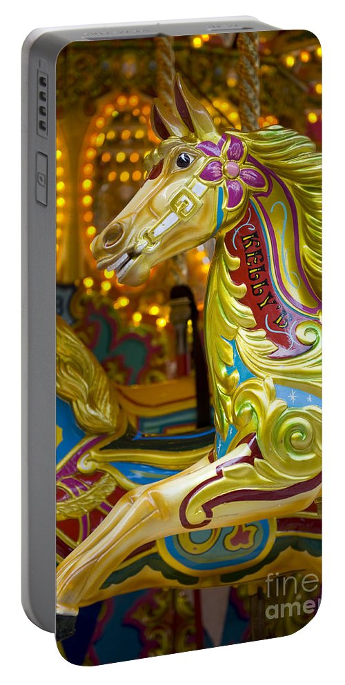 Amusement Portable Battery Charger featuring the photograph Fairground Carousel by Lee Avison