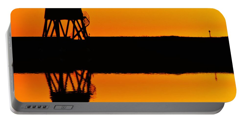 Groyne Portable Battery Charger featuring the photograph Groyne Lighthouse At Sunrise by David Pringle
